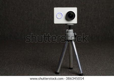 White Action Camera at Dark - stock photo