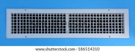White air vent on blue wall - stock photo