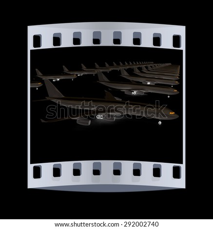 White airplanes on a black background. The film strip - stock photo