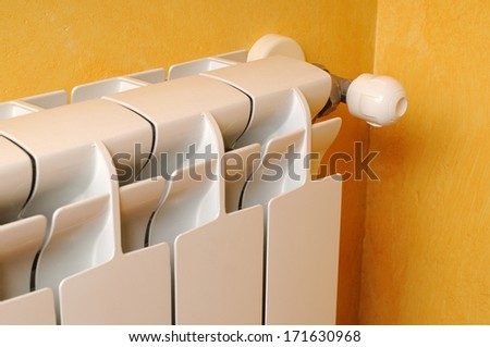 White aluminum heating radiator lateral view - stock photo