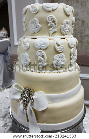 White and beige wedding cake