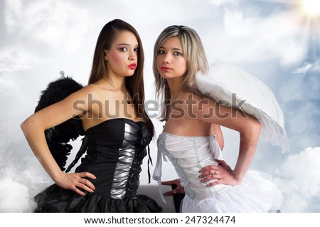 white and black angels - stock photo