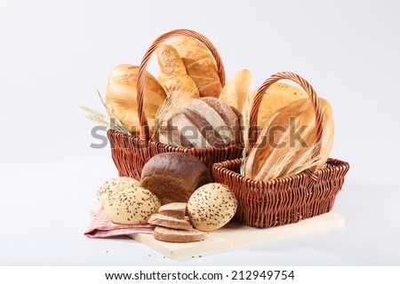 White and black bread in basket