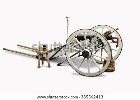White and black cannon with complete accessories isolated in white background.