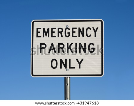 white and black emergency parking only road sign with blue sky background - stock photo