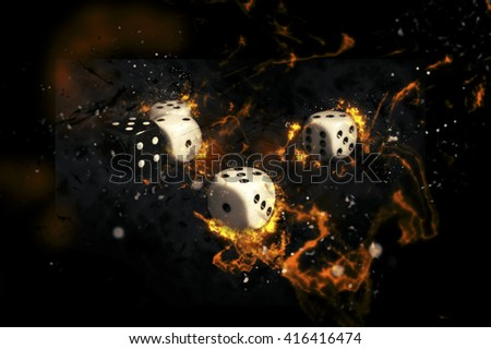 White and black gambling dices on fire. - stock photo