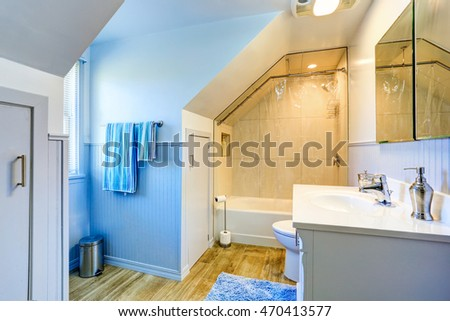 White  and blue bathroom with shower and vaulted ceiling. Northwest, USA