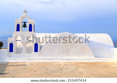 White and blue bell tower of traditional church on Santorini island, Greece - stock photo