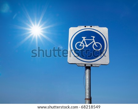 White and Blue Bicycle Traffic Sign and sky