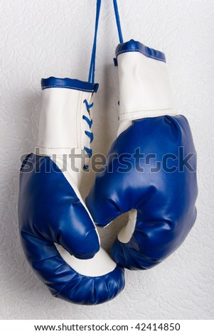 White and blue boxing gloves - stock photo