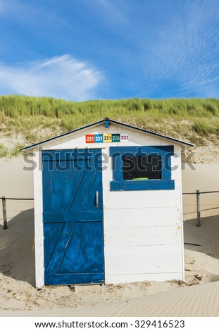 White and  blue cabin on the beach on the isle of Texel.