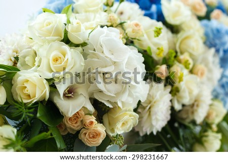 white and blue flowers in wedding decoration