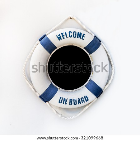 White and blue lifebuoy on white wall, float on the wall - stock photo