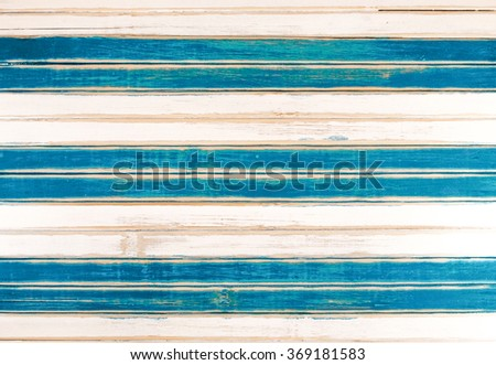 White and blue wooden planks texture, shabby and scratched.