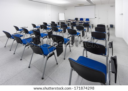 white and bright modern learning, conference or meeting room - stock photo