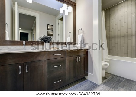 brown bathroom. White and brown bathroom boasts a nook filled with double vanity cabinet  topped white counter Brown Bathroom Boasts Nook Filled Stock Photo Royalty Free