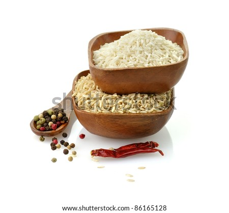 white and brown organic rice in wooden bowls
