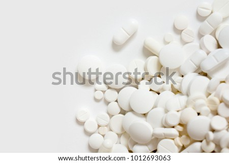 white and colored tablets