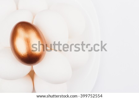 White and gold chicken eggs, white background - stock photo
