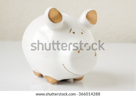 White and Gold Piggy Bank