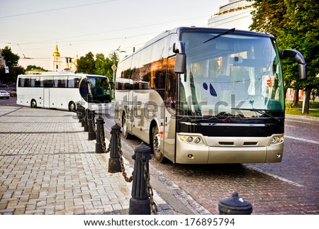 White and gray bus on the road - stock photo