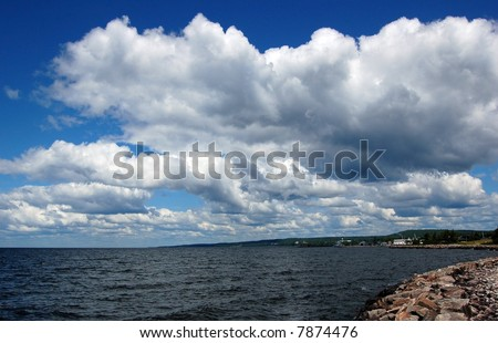 White and gray clouds above lake