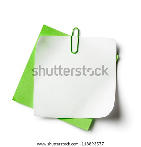 White and green note papers with paperclip on white background
