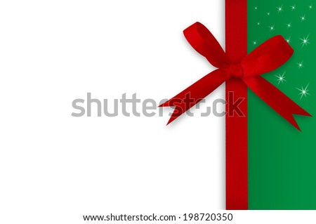 White and green paper card with a red bow on a white background. - stock photo