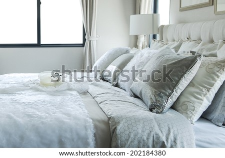 white and grey pillow on bed - stock photo