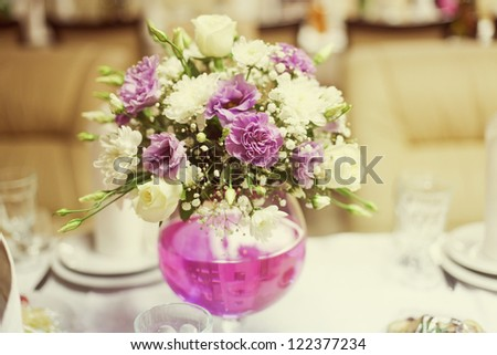 white and pink wedding bouquet on the table - stock photo