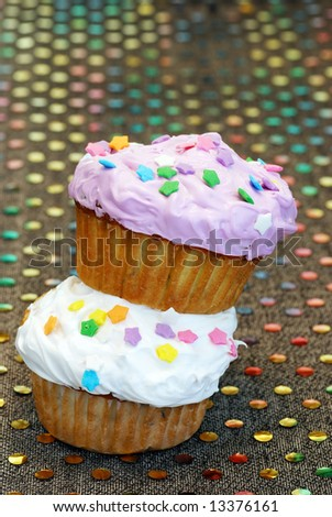 white and purple cupcakes stacked