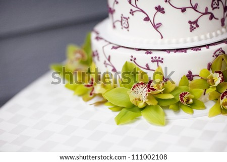 White and Purple Wedding Cake with Flowers - stock photo