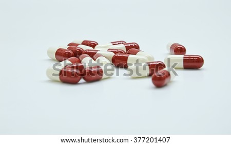 white and red capsules