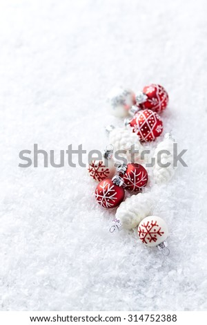 White and red christmas balls on white snow  - stock photo