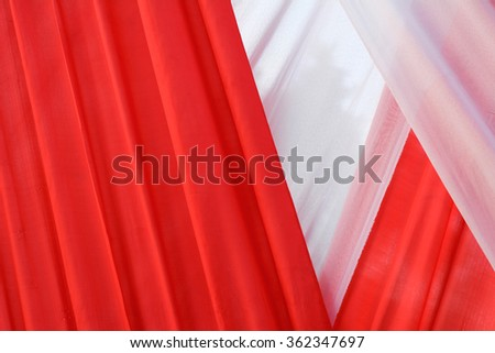 White and red cloth background abstract with soft waves.
