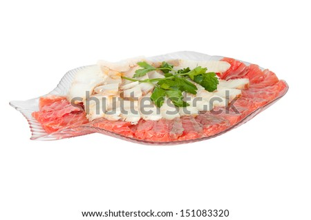 white and red fish in a plate on a white background