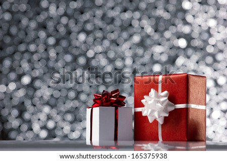 white and red gift boxes on black & white  bokeh background - stock photo