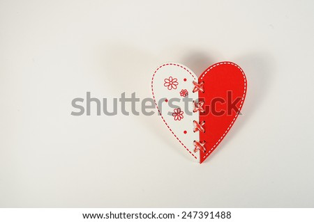 white and red heart buttons on white background