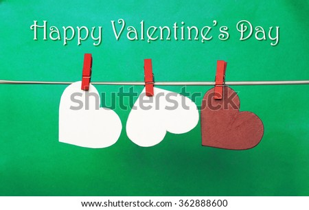white and Red hearts with clothespins hanging on clothesline on blue background. date, love Happy Valentines Day concept. 14 february. space for name - stock photo