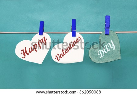 white and Red hearts with clothespins hanging on clothesline on red background. date, love Valentines Day concept - stock photo