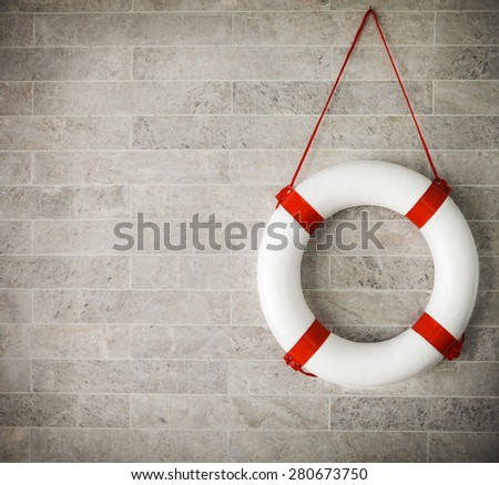 White and red lifebuoy at background, copyspace for your text - stock photo