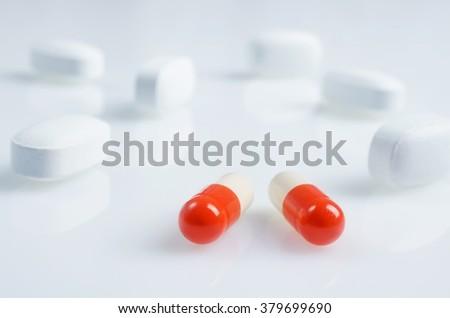 White and red medicine antibiotic pills - stock photo