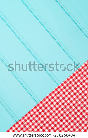 White and red towel over wooden kitchen table. View from above. - stock photo