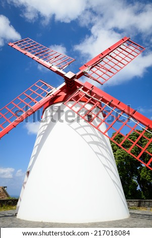 White and red windmill against blue sky, Sao Miguel, Azores, Portugal, Europe - stock photo
