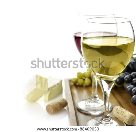 White And Red Wine Glasses With Cheese And Grape - stock photo