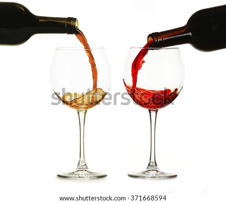 White and red wine pouring in glasses, isolated on white - stock photo