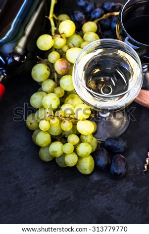white and red wine with fresh grapes, from above - stock photo