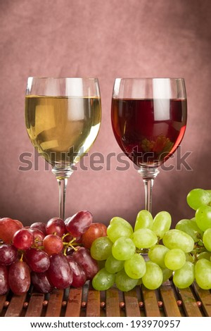 White and red wine with green and red grapes