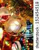 White and silver glass Christmas globe hanging on a Christmas tree, England, UK, Western Europe. - stock photo