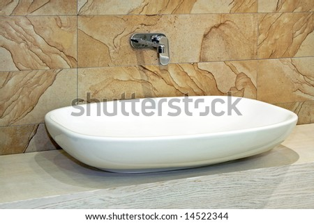 White and wide basin and marble wall - stock photo